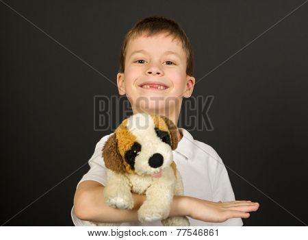 grimacing boy portrait on black background