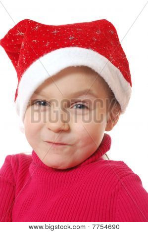 Funny Face Of Child Wearing Red Santa's Hubcap.