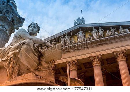 parliament in vienna, austria. seat of government. statue of pallas athena, goddess of weiheit.