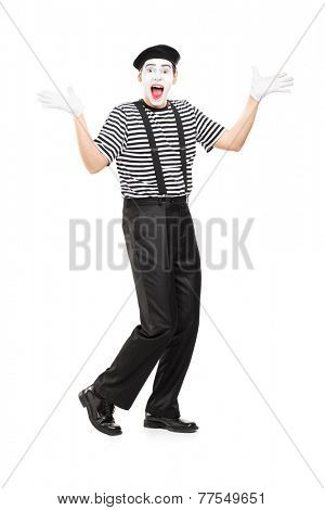 Full length portrait of a mime artist gesturing joy with his hands isolated on white background