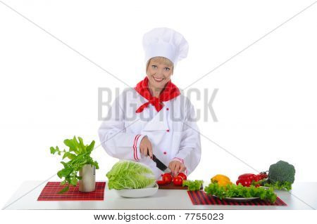 Young Girl Cuts The Tomatoes In The Kitchen.