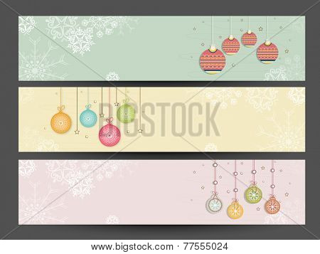 Beautiful website header or banner set decorated with hanging X-mas Balls for Merry Christmas and Happy New Year 2015 celebration.