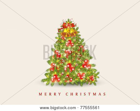Beautiful X-mas Tree decorated by jingle bell and mistletoe for Merry Christmas celebration on beige background