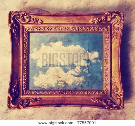 an antique photo frame with a cloud in it  toned with a retro vintage instagram filter effect