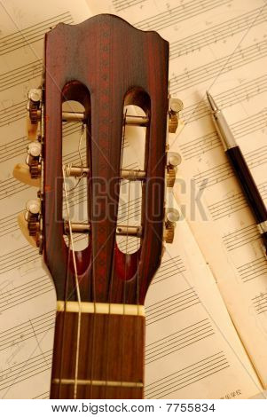 Guitar With Pen On Music Manuscript