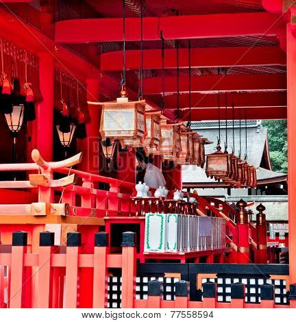 KYOTO, JAPAN-OCT 20, 2014: Procession in Fushimi Inari Shrine on Oct 20, 2014 in Kyoto, Japan. Fushimi Inari Shrine is famous for thousands of bright red Torii Gates.