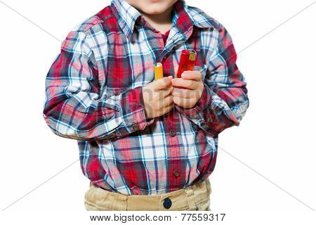 Little boy holding a firecrackers. Selective focus