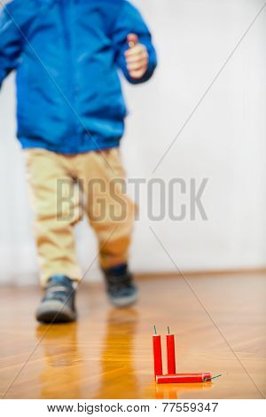 Little Boy and firecrackers, - selective focus,