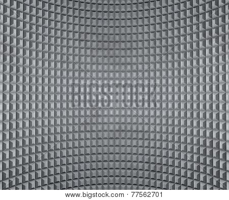 Grey inflected wall with extruded squares texture.