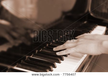 Hands Above Keys Of The Piano. Old Color