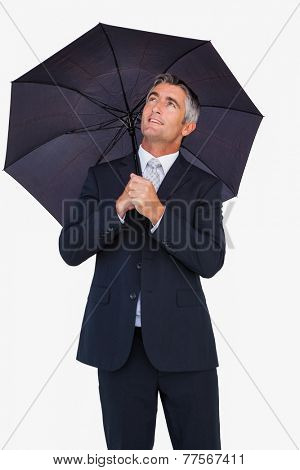 Smiling businessman sheltering with umbrella on white background