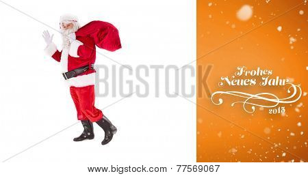 Santa holding a sack and waving against orange vignette