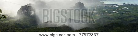 Tropical rain over valley with mountains. Krabi province of Thailand