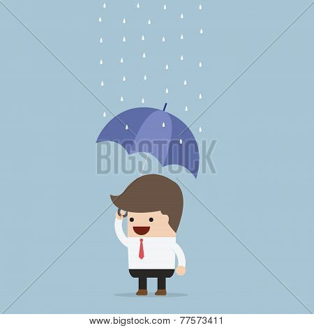 Businessman Holding An Umbrella Under The Rain
