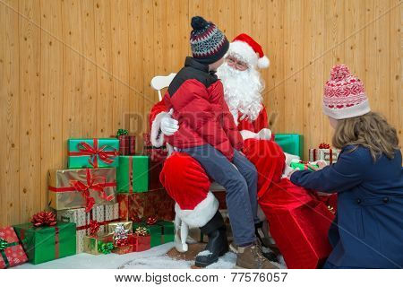 Children visiting Santa in his Christmas grotto