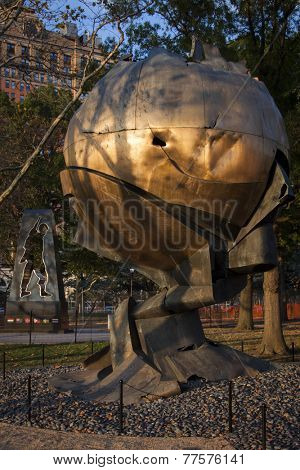 NEW YORK - SEPT 11, 2014: The Universal Soldier Monument that honors Korean War Veterans and the Sphere sculpture by Fritz Koenig, damaged in the terror attacks of Sept 11, 2001, in Battery Park.