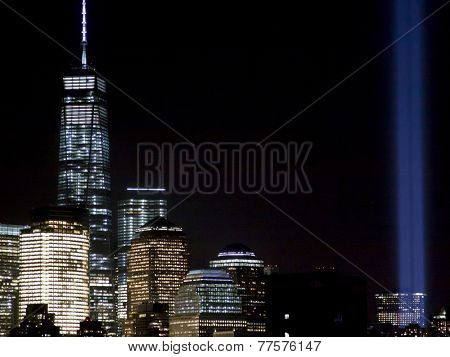 HOBOKEN, NJ - SEPT 11, 2014: New York City skyline with One World Trade Center and the annual Tribute in Light in Lower Manhattan on the anniversary of the terrorist attacks at Ground Zero in NYC.