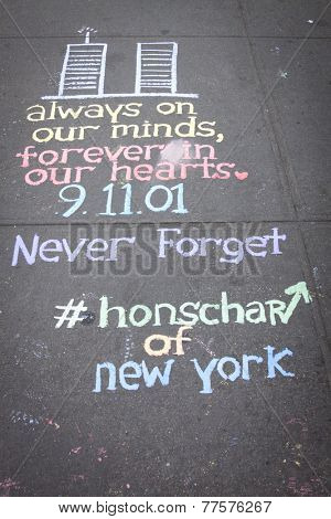 NEW YORK - SEPT 11, 2014: A drawing of the World Trade Center twin towers and a quote written in colorful chalk by New York City artist Hans Honchar on the sidewalk near the WTC in Manhattan.
