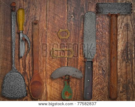 vintage kitchen utensils  over wooden working wall, space for text and name