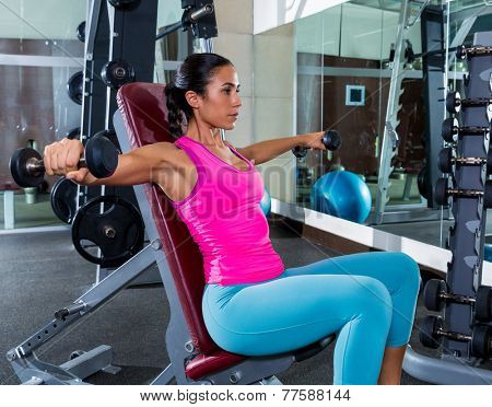 girl seated dumbbell shoulder flies fly workout exercise at gym