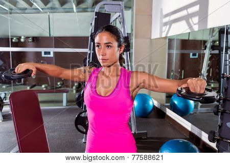 brunette girl plate raise flies fly workout at gym exercise
