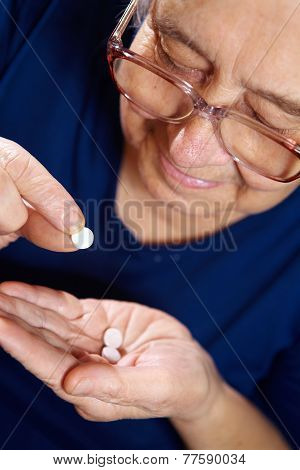 Senior Female With Pills