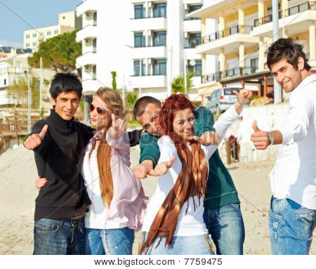 Turkish Students Showing Thumbs Up On The Beach .