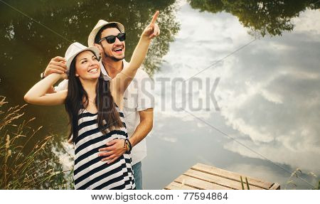 Embrace Of Happy Romantic Couple On Pier Explore The World Of Beautiful Fauna