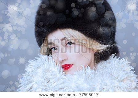 Winter Woman in Luxury Fur Coat. Beauty Fashion Model Girl. Beautiful winter girl in winter knitted