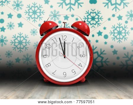 Alarm clock counting down to twelve against snowflake wallpaper over floor boards