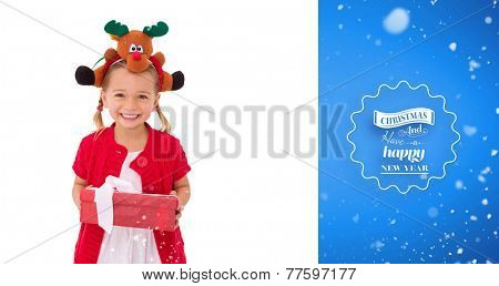 Cute little girl wearing rudolph headband against blue vignette