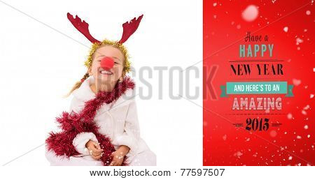 Cute little girl wearing red nose and tinsel against red vignette