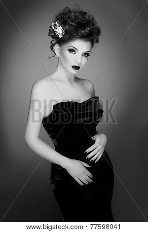Fashion photo of beautiful lady in elegant evening dress. Black and White