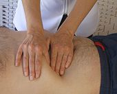 picture of pressure point  - Female therapist performing abdominal examination on male torso - JPG