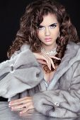 picture of mink  - Beautiful fashion brunette girl in mink fur coat isolated on black background - JPG