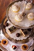 picture of cake stand  - A selection of delicious desserts arranged and served on a silver cake stand in an english high tea style - JPG
