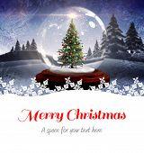 foto of cursive  - Merry christmas against christmas tree in snow globe - JPG