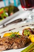pic of flambeau  - steak with a rosemary leaf with wine - JPG