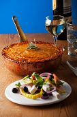 pic of ouzo  - baked moussaka dish on a wooden board - JPG