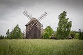 stock photo of fidget  - Wooden mill on the field in Poland - JPG