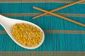 stock photo of citronella  - Dehydrated lemon grass on a traditional bamboo mat - JPG