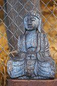 image of gautama buddha  - An ancient wooden Sakyamuni statue close up thin D - JPG