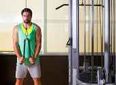 stock photo of pulley  - Triceps pressdown high pulley workout man at gym exercise - JPG