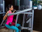 stock photo of lats  - Lat Lateral dorsal pulldown machine upper back exercises woman at gym workout - JPG