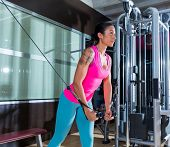 stock photo of pulley  - Standing cable crossover fly pulley flies woman workout at gym - JPG
