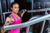 foto of lats  - Lat Lateral dorsal pulldown machine upper back exercises woman at gym workout - JPG