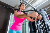 picture of pulley  - Standing cable crossover fly pulley flies woman workout at gym - JPG
