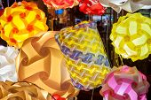 picture of lamp shade  - Close up of colorful lamp shades brightly lit - JPG