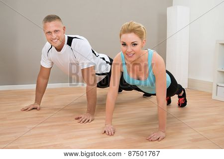 Young Couple Doing Pushups