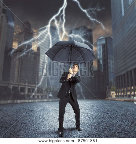 Businessman against lightning